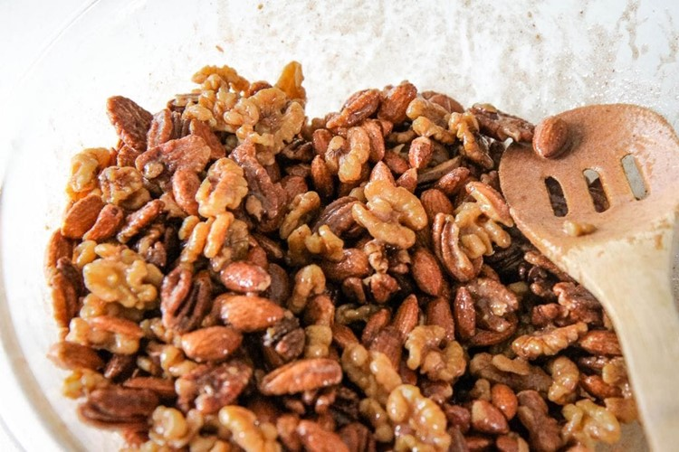 Tossing Sugar & Spice Candied Nuts With Egg Whites
