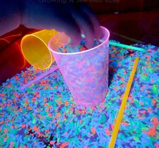 glowing rainbow rice sensory play 08