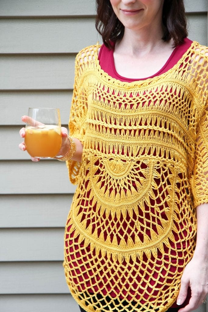 wine tank + crocheted mustard sweater + black leggings