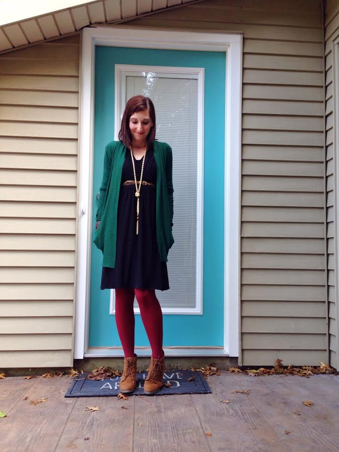 green loose cardigan + black dress + tassel necklace + burgundy tights + camel colored booties