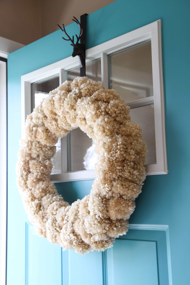 How to make a yarn pom pom wreath momadvice for How to make christmas door wreaths