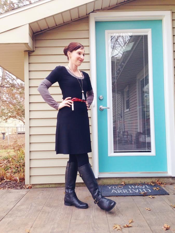black dress + gray seamless shirt + black boots & tights + red belt + tassel necklace