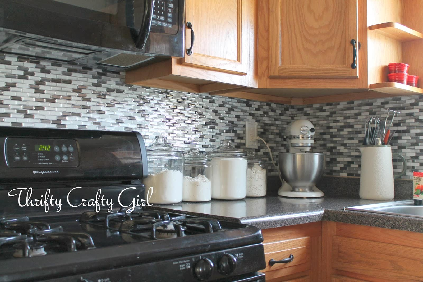 Peel-Stick Backsplash Tiles via Thrifty Crafty Girl
