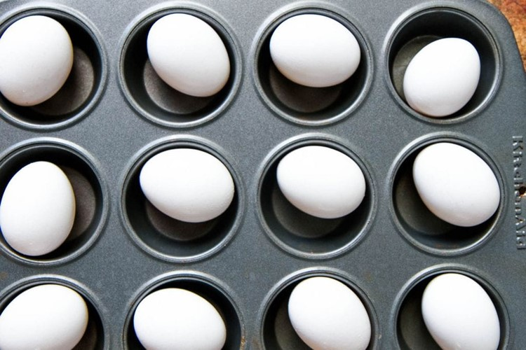 Hard Boiled Eggs In The Oven Recipe Placed in Muffin Tin
