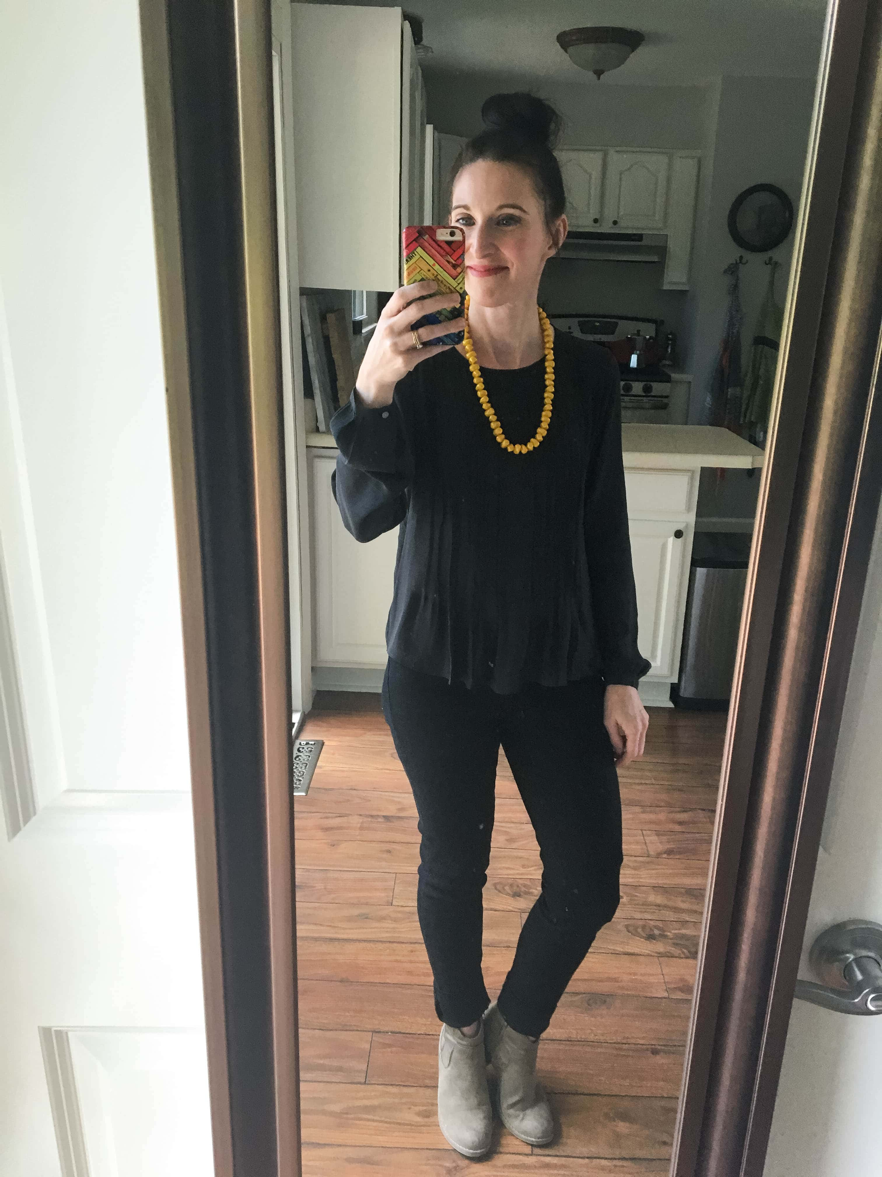 All black, mustard necklace, & suede booties