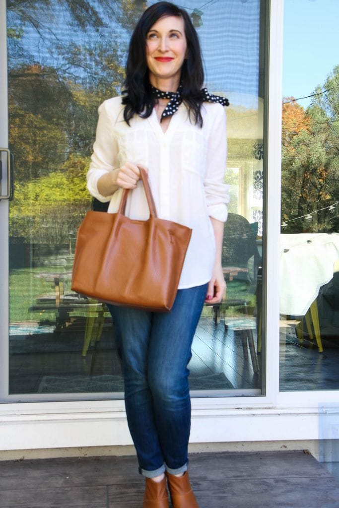 white blouse + polka dot scarf + tan bag + tan booties + dark denim