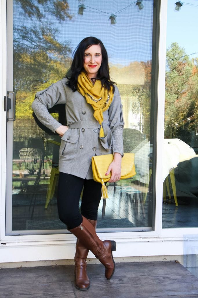 gray cardigan over gray shirt + black leggings + tan boots + mustard accessories