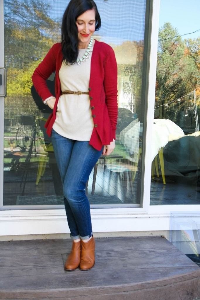 peplum burgundy sweater + mint statement necklace + leopard print belt + ivory shirt + dark denim + tan booties